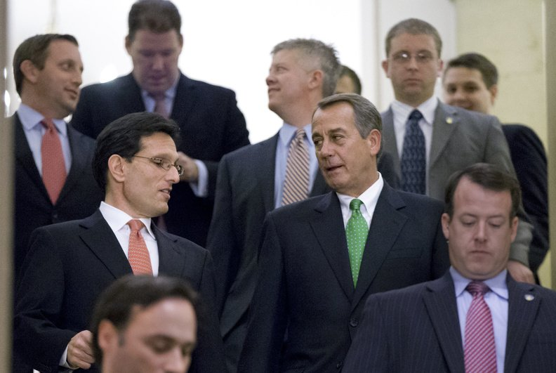 Speaker of the House John Boehner, R-Ohio, center right, and House Majority Leader Eric Cantor, R-Va., center left, walk down stairs to a second Republican conference meeting to discuss the