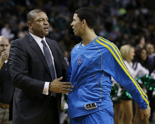 Boston Celtics head coach Doc Rivers greets his son New Orleans Hornets shooting guard Austin Rivers prior to an NBA basketball game in Boston on Wednesday. The Hornets won 90-78. TD Garden