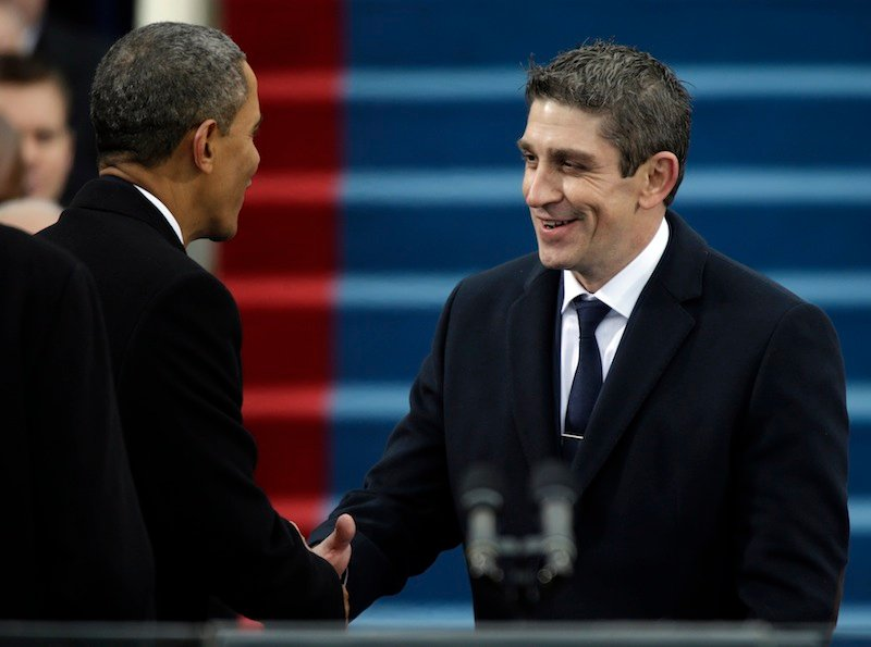 President Barack Obama, left, shakes hands with poet Richard Blanco during the ceremonial swearing-in West Front of the U.S. Capitol during the 57th Presidential Inauguration in Washington, Monday, Jan. 21, 2013. (AP Photo/Pablo Martinez Monsivais) Inauguration;US Capitol