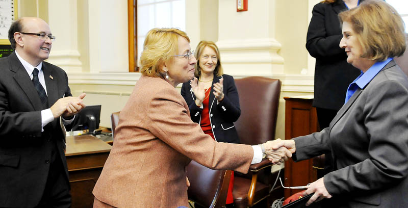 Attorney General Janet Mills, center, greets Pola Buckle, who was sworn in as state auditor, on Monday in Augusta. Matt Dunlap, left, was sworn in as secretary of state and Neria Douglass, third from left, was sworn in as state treasurer during a ceremony in the House of Representatives.