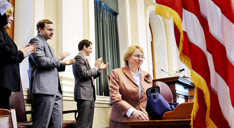 Incoming Attorney General Janet Mills is applauded by Maine Senate President Justin Alfond, second from right, Speaker of the House Mark Eves and Maine Supreme Judicial Court Chief Justice Leigh Saufley during Monday ceremonies at the House of Representatives.