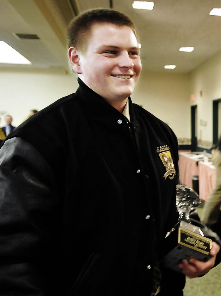 TAKING IT HOME: 2012 Gaziano Offensive Lineman award winner Bobby Begin holds his trophy during the awards ceremony Sunday in Augusta.