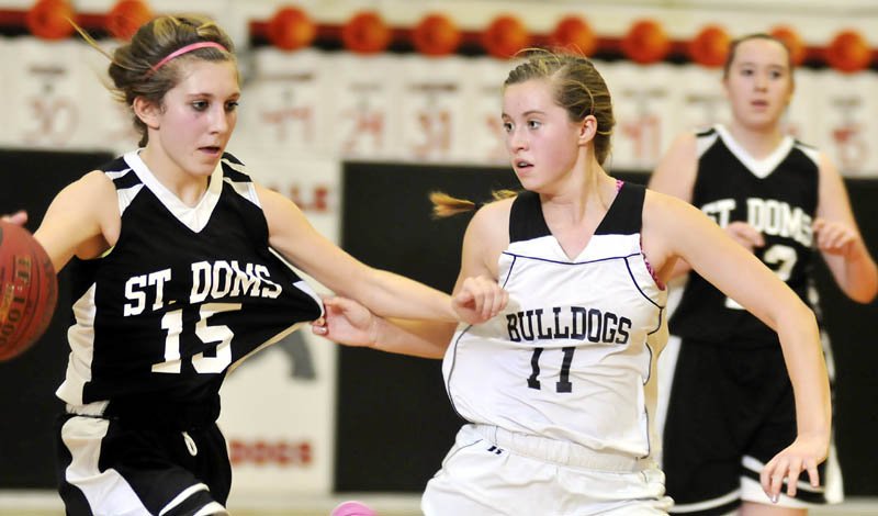 CLOSELY DEFENDED: Hall-Dale High School's Nicole Pelletier, right, defends St. Dominic Academy's Kelly Pomerleau on Thursday in Farmingdale.