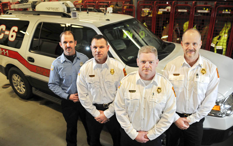 Augusta Fire Department's new officers, Lt. Jason Farris, left, Battalion Chief John Bennett, Deputy Chief David Groder and Battalion Chief Scott Dunbar, with the new incident command vehicle at Hartford Station on Wednesday.