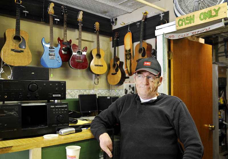 Lonnie Babb waits for a customer Wednesday at the Gardiner Trading Post, the pawn shop he operates. Babb is opposed to a proposed legislation that will put more restrictions on pawn shops.