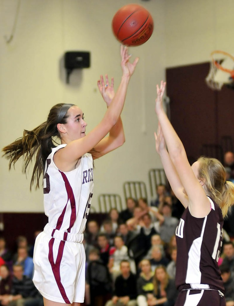 MILESTONE: Richmond High School's Jamie Plummer makes a basket for her 1,000th career point in a game against Buckfield High School on Tuesday in Richmond. The Bobcats won 48-9.