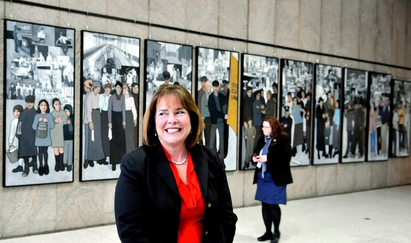 Jeanne Paquette, Maine's commissioner of labor, unveiled the labor murals on display on the wall of the Cultural Building atrium that serves as the entryway to the Maine State Museum in Augusta Monday January 14, 2013. The murals were hung over the weekend after being removed by Gov. Paul LePage in 2011 from the Department of Labor.