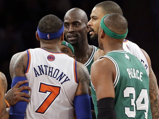New York Knicks' Carmelo Anthony and Boston Celtics' Kevin Garnett, center, exchange words after both received technical fouls as Celtics' Paul Pierce (34) and Knicks' Tyson Chandler look on during the second half of Monday's game at Madison Square Garden.