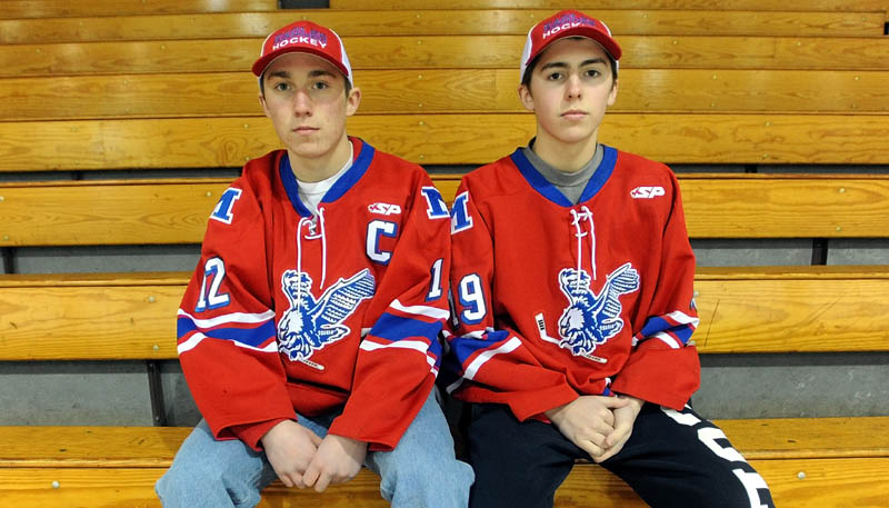 BROTHER ACT: Brothers Chase, left, and Jared Cunningham form a potent duo for the Messalonskee boys hockey team. In 10 games, the brothers have combined to score 36 goals and dish out 44 assists.