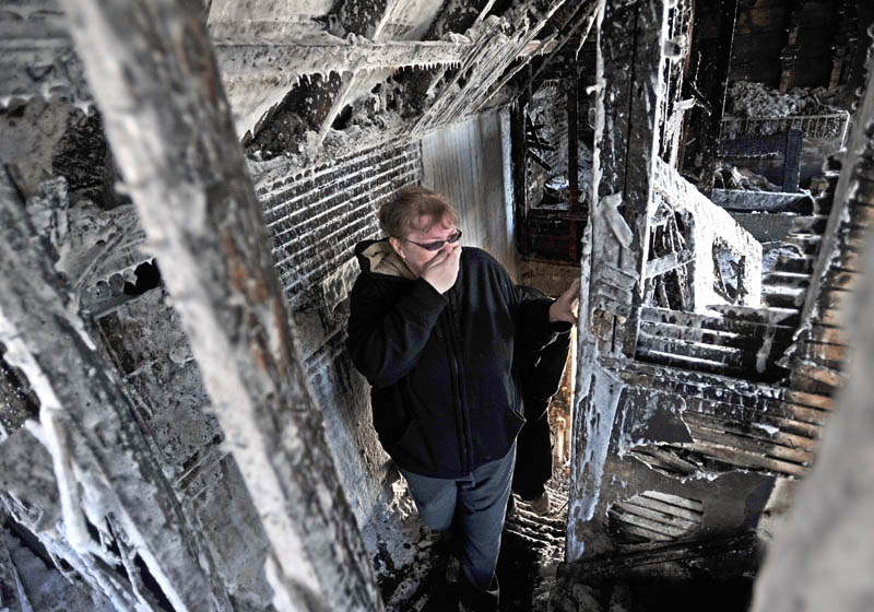 Becky Williams, 40, becomes emotional as she looks at the second floor her parents' Madison Avenue home, which was destroyed by fire around 3 a.m. Friday.