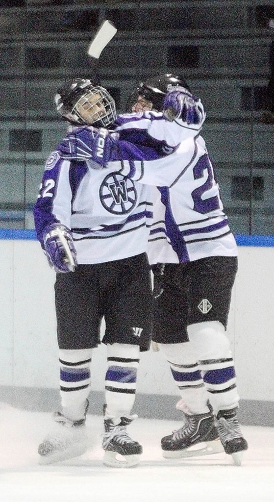 NICE JOB: Waterville junior forward Denis Dalton, left, gets a hug from teammate junior defenseman Todd Serbent after Dalton scored the Panthers first goal of a game against MHW on Thursday at Colby College in Waterville.
