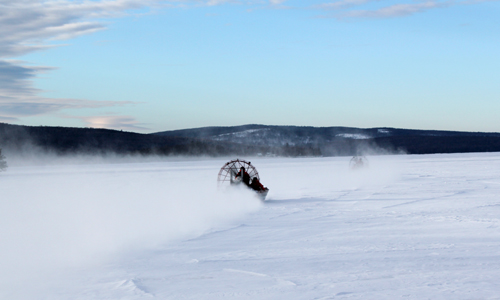 Maine Warden Service airboats drive out toward the open water on Rangeley Lake Thursday morning in search of three missing snowmobilers who are presumed dead.