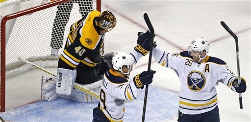 Buffalo Sabres left wing Thomas Vanek, right, of Austria, is congratulated by teammate Jason Pominville after beating Boston Bruins goalie Tuukka Rask, rear, during the third period of an NHL hockey game in Boston, Thursday, Jan. 31, 2013. Vanek scored three goals in the Sabres' 7-4 win. (AP Photo/Charles Krupa)