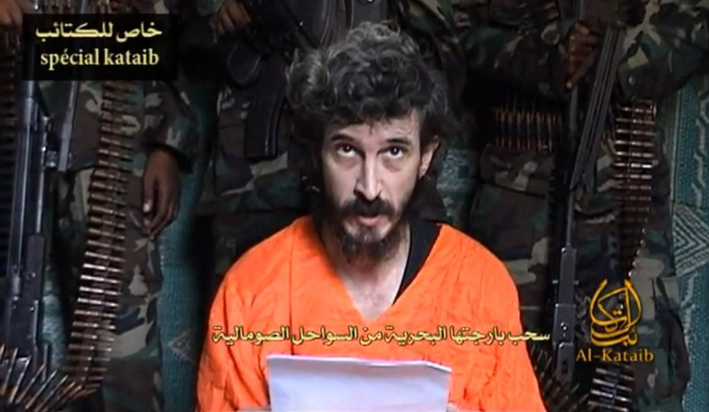 In this undated file image from a video posted on Islamic militant websites and made available June 9, 2010, a man identified as a French security agent with the cover name of Denis Allex pleads for his release from the Somali militant group al-Shabab. President Obama said Sunday that U.S. military fighter jets provided backup support to a failed French mission to rescue Allex, who is presumed dead.