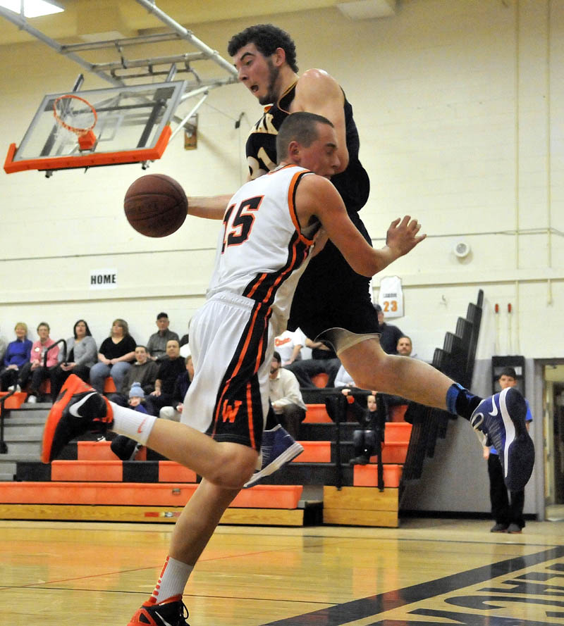 Medomak Valley High School's Ryan Ripley, right tries to throw the ball off of Winslow High School's Justin Kervin before going out of bounds in the first quarter Tuesday at Winslow High School. Winslow defeated Medomak Valley 73-61.