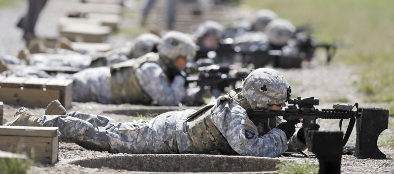 Female soldiers from 1st Brigade Combat Team, 101st Airborne Division train on a firing range while testing new body armor in Fort Campbell, Ky., in preparation for their deployment to Afghanistan. The Pentagon is lifting its ban on women serving in combat, opening hundreds of thousands of front-line positions and potentially elite commando jobs after generations of limits on their service, defense officials said Wednesday.