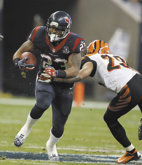 THREAT: Houston Texans running back Arian Foster, left, ran for 46 yards against the New England Patriots in a regular season game last month.