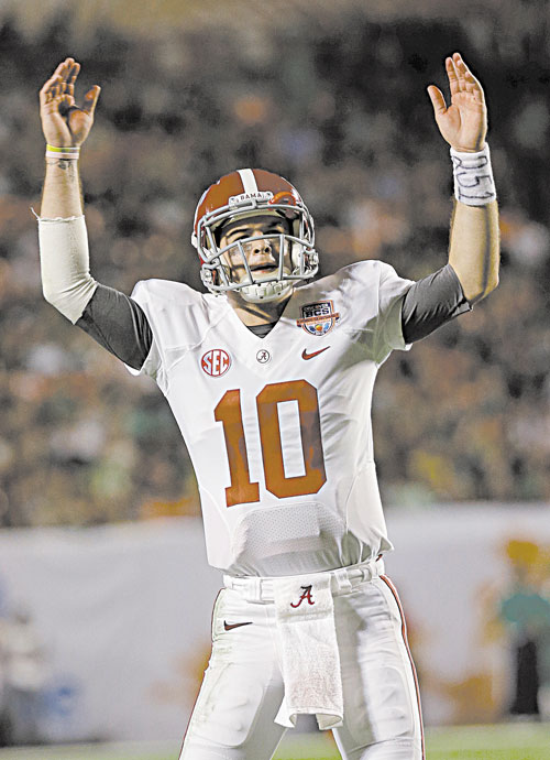 WE DID IT: Alabama quarterback AJ McCarron celebrates during the second half against Notre Dame in the BCS national championship game Monday in Miami. The Crimson Tide won 42-14 for their second title in a row and third in four years.