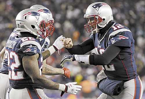 READY TO GO: Quarterback Tom Brady (12) and running back Stevan Ridley (22) will lead the New England Patriot offense against the Houston Texans in the AFC division playoffs Sunday in Foxborough, Mass. The Patriots beat the Texans 42-14 earlier this season.