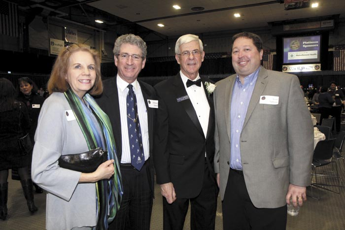 From left, Diane Doyen with husband and Augusta Mayor William Stokes, Kennebec Valley Chamber of Commerce President Peter Thompson and Scott Upham of Cribstone Capital Managagement at the Kennebec Valley Chamber of Commerce's annual awards banquet, at the Augusta Civic Center on Friday night.