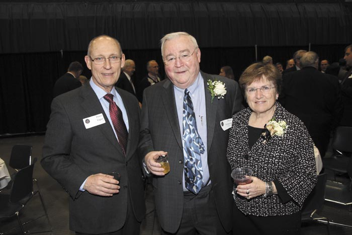 From left, Peter Vigue with Kennebec Valley Chamber of Commerce Lifetime Achievement Award recipient Peter Prescott, of Everett J. Prescott, Inc. and wife, Sandra, at the Kennebec Valley Chamber of Commerce's annual awards banquet at the Augusta Civic Center on Friday night.