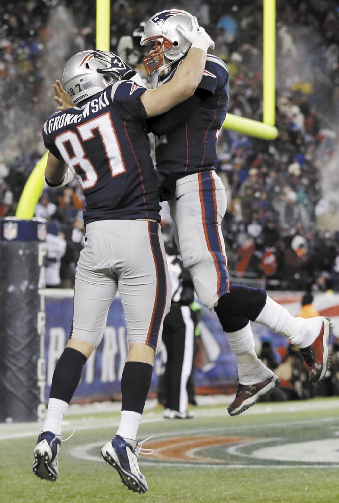 MORE TO CELEBRATE? New England Patriots quarterback Tom Brady, right, celebrates tight end Rob Gronkowski during a regular season game. The Patriots face the Houston Texans in an AFC divisional round game today in Foxborough, Mass. NFLACTION12; Gillette Stadium