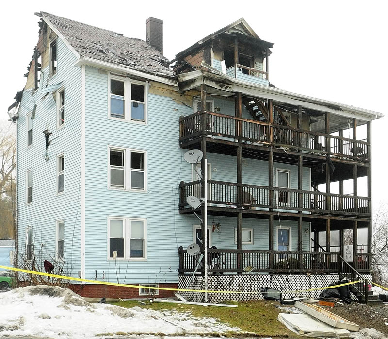 The fire at 1 Penobscot St. on Thursday damaged the four-unit building and left 13 people homeless