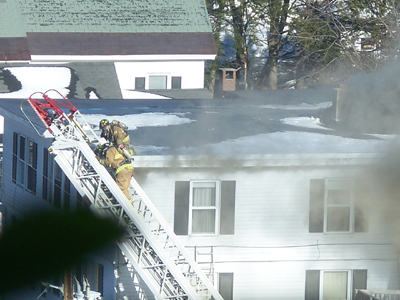 Photo courtesy of Cassie Chase Firefighters battle a blaze Thursday afternoon at 55 Sewall St., Augusta, near St. Michael School.