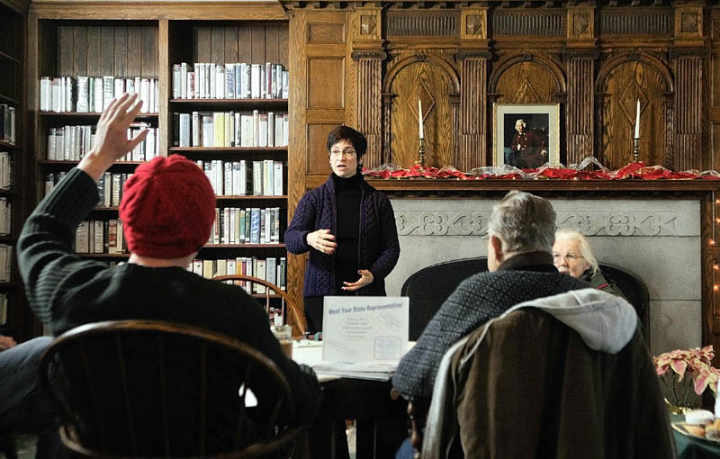Todd Martin, left, asks a question of Rep. Gay Grant, D-Gardiner, during a fireside chat on Saturday in the Hazzard Reading Room at the Gardiner Public Library.