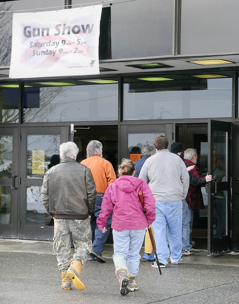 The line to get into the Augusta Gun Show on Saturday stretched out the door and included several rows snaking through the lobby of the Augusta Civic Center.