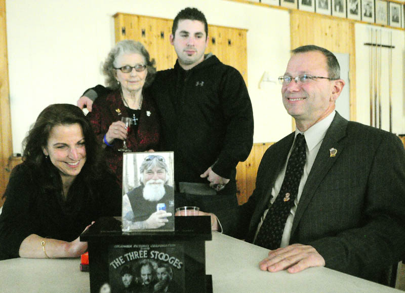 At a luncheon after the sentencing hearing for David Silva, convicted of killing Robert Orr in 2011, Orr family members sit behind a photo and Robert Orr's urn, telling stories about the murdered man on Friday, at the Alfred W Maxwell Jr. Post 40 American Legion hall in Winthrop. They are from left, Nancy Mooney, sister, Emily Orr, mother, Robert Orr, son, and Raymond Orr, brother.