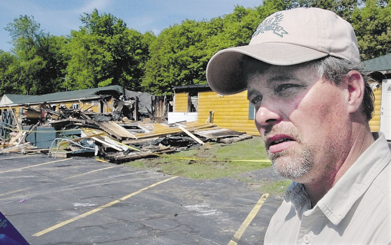 Former Grand View Topless Coffee Shop owner Donald Crabtree, seen at the scene of the fire that destroyed the building on June 3, 2009. Crabtree, his two daughters, their infant children and their boyfriends were living in the former motel at the time and were at home when the fire was set.