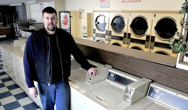 David Folsom stands inside the closed Butler's Cleaners in Skowhegan on Tuesday. Folsom is planning to reopen the store in mid-March and offer laundry services and a used auto lot.