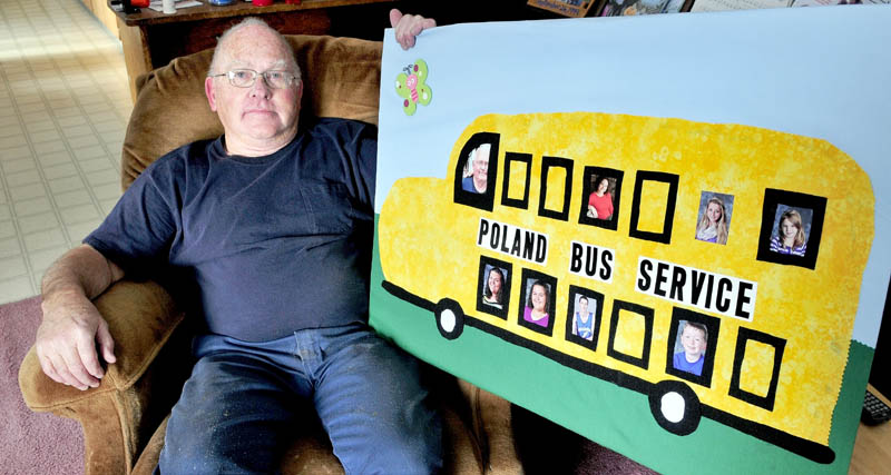 Gib Poland, of Cornville, sits back with a sign he received from his daughter and grandchildren, after a recent retirement party celebrating his 47 years as a school bus driver.