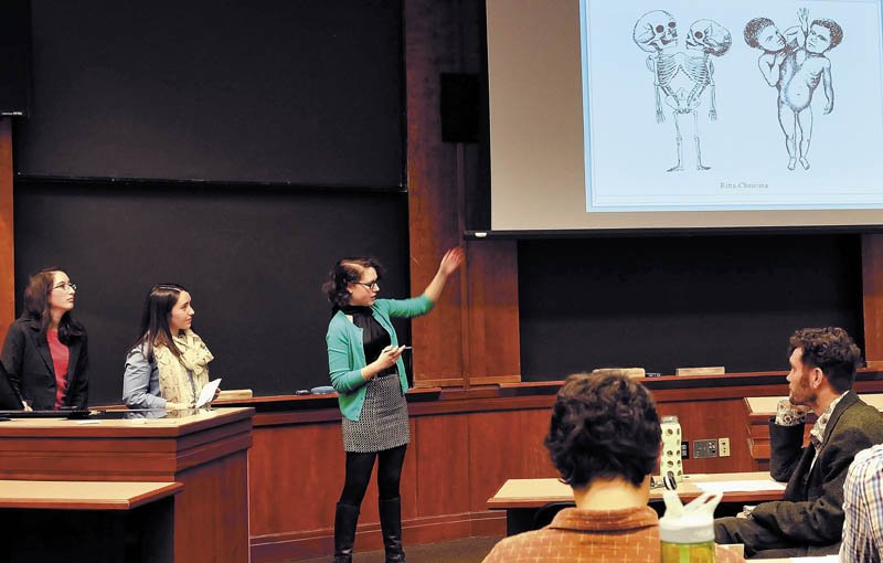 Colby College anatomy class students from left, Erin Bewley, Kali Stevens and Erin Hoover discuss their study on conjoined twins during presentations held at Colby College on Wednesday. Listening at right is professor Thomas Klepach.