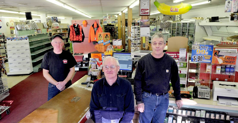 Jerry Keay, left, Daryl Keay and Kevin Keay, all grandsons of Harold Keay, are pictured inside the H.L. Keay & Son store in Albion on Wednesday. The store is closing, probably this week, after 86 years in business.