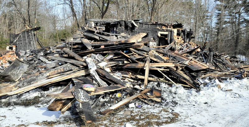 Remains of part of a huge barn that burned on Saturday at the home of Maine filmmaker Richard Searls, on the River Road in Solon. Lost in the fire were tractors, farm equipment, tools and a lifetime of master film reels and original videotape.