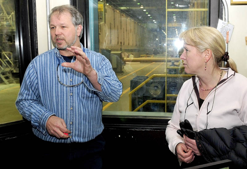 Sappi Fine Paper Plant Manager Tony Ouellette and Marketing Director Heather Pelletier discuss the Skowhegan mill from a control room inside the mill Thursday.