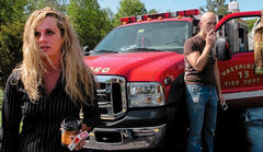 Grand View Topless Coffee Shop employee Krista MacIntyre, and former employee Alan Brown, arrive at the fire scene that destroyed the topless restaurant in Vassalboro on June 6, 2009. The state argued at trial that Raymond Bellavance Jr., who was dating MacIntyre, burned the building in revenge against coffee shop owner Donald Crabtree, whom MacIntyre was also dating.