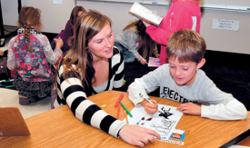 Cornville Regional Charter School teacher Danielle Beaman helps student Barret Walker last fall. The school opened in October with 60 students and plans to expand to 90 this fall.