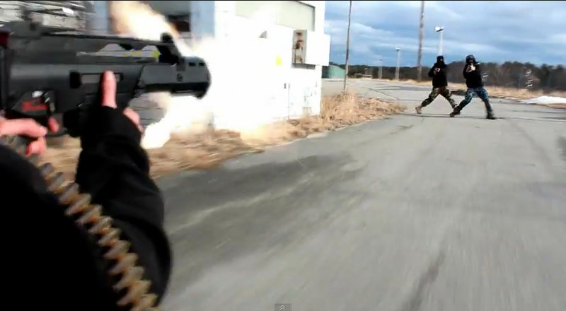 "A young actor aims a weapon at two others in this screen image of a scene from ""The Extraction,"" one of more than two dozen violent videos produced by USN Films of Brunswick."
