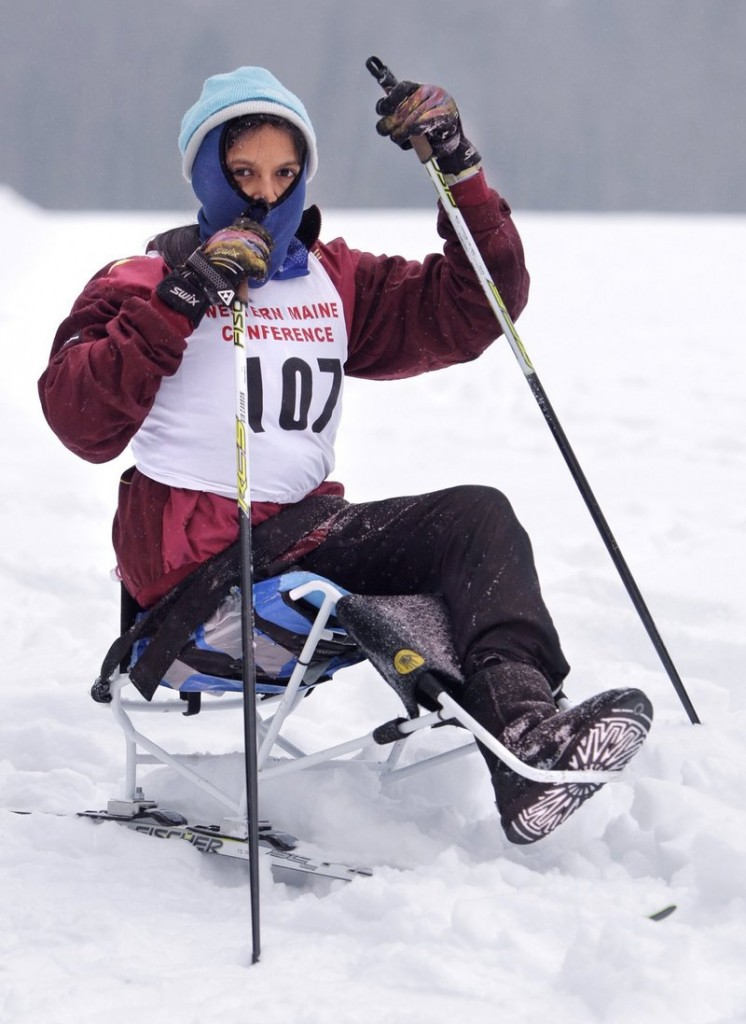 Christina Kouros uses a sit-ski to compete on the Cape Elizabeth Nordic ski team in 2011. The federal Department of Education on Friday told schools nationwide that they must provide sports opportunities for disabled students. State officials say that is already happening in Maine.