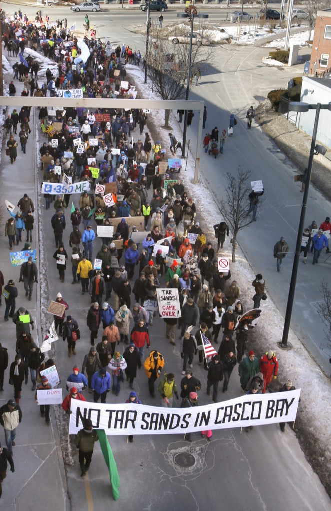 Police estimate as many as 1,500 people marched to the Maine State Pier in Portland on Saturday to protest the possible use of the Portland-to-Montreal Pipe Line to transport tar sands oil.
