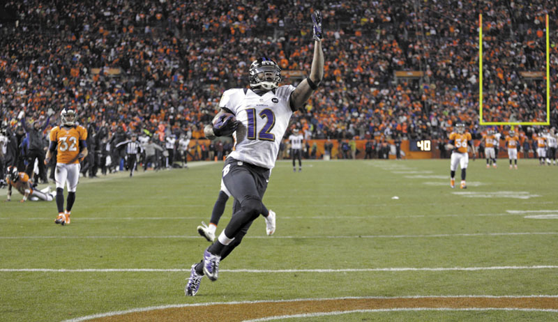 GAME CHANGER: Baltimore Ravens wide receiver Jacoby Jones celebrates as he crosses the goal line for a touchdown late in the fourth quarter against the Denver Broncos in an AFC divisional playoff game, Saturday in Denver. Sports Authority Field at Mile