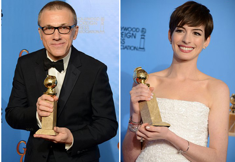 """Christoph Waltz and Anne Hathaway pose with their awards backstage at the 70th Annual Golden Globe Awards on Sunday. Waltz won for best performance by an actor in a supporting role in a motion picture for """"Django Unchained."""" Hathaway won for best performance by an actress in a supporting role in a motion picture in"""