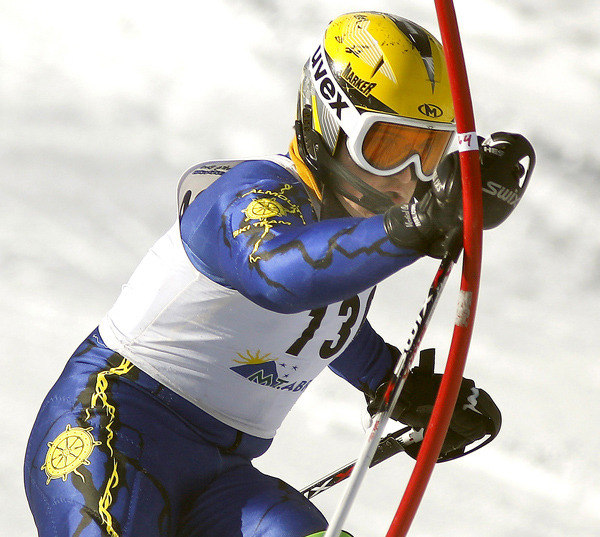 Joseph Lesniak of Falmouth slams down a gate while competing in the slalom race Wednesday at the Class A skiing state championships at Mt. Abram. Lesniak finished fourth, helping the Yachtsmen capture overall and Alpine titles to go with the Nordic championship they won a day earlier.