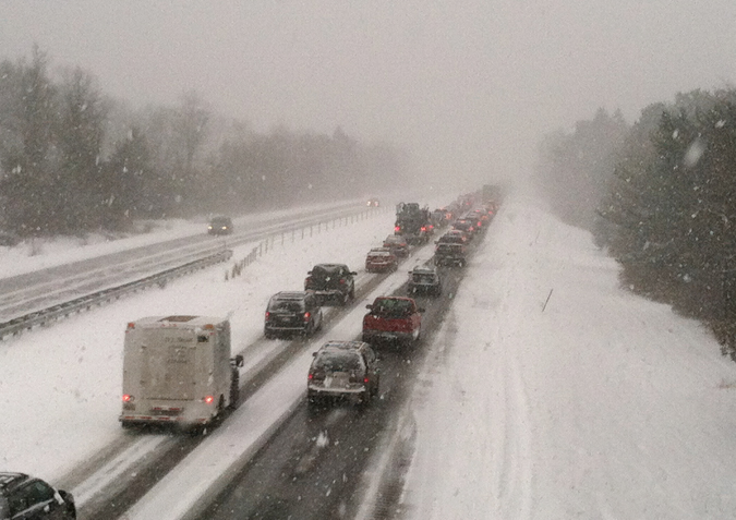 This view from Tuttle Road in Cumberland shows traffic stalled on I-295 southbound Friday morning after a 19-vehicle pileup.
