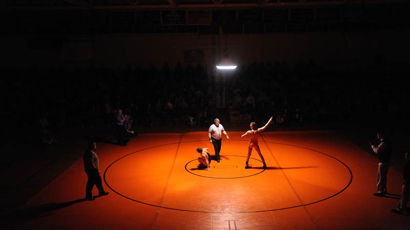 CENTER OF ATTENTION: Skowhegan Area High School's Kameron Doucette, right, celebrates his win over Mt. Blue High School's Kevin Moore, in the 132-pound Eastern A championship bout Saturday at Skowhegan Area High School.