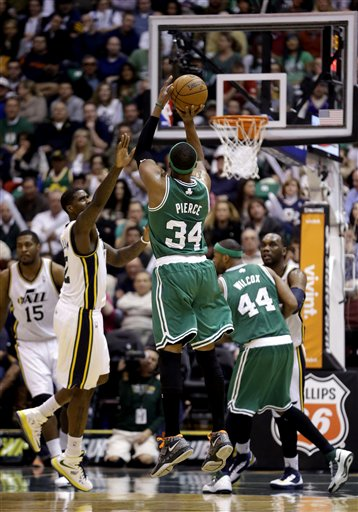 Boston Celtics' Paul Pierce (34) shoots as Utah Jazz's Marvin Williams (2) defends in the second half during an NBA basketball game Monday, Feb. 25, 2013, in Salt Lake City. The Celtics defeated the Jazz 110-107. (AP Photo/Rick Bowmer)