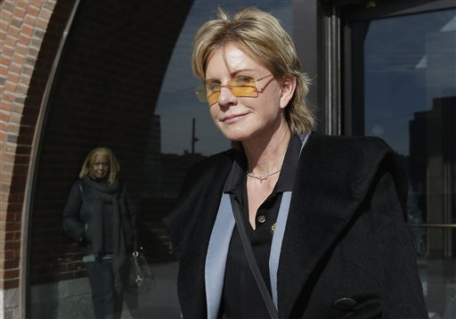 Author Patricia Cornwell leaves federal court in Boston on Feb. 7, 2013. A federal jury awarded Cornwell nearly $51 million Tuesday in her lawsuit against her former financial management company.